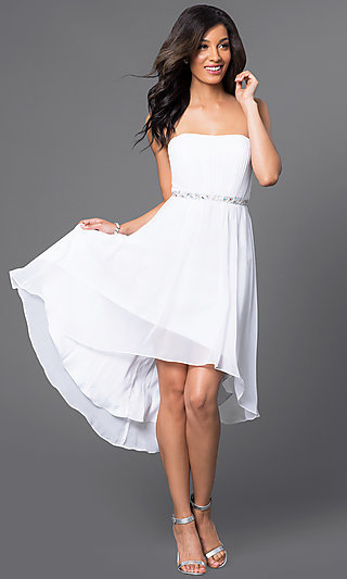 White mini dress with silver cage strap back
