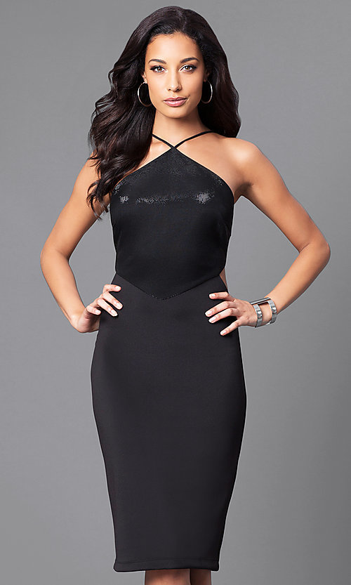 Image of black knee-length party dress with side cut outs. Style: JU-49272 Front Image