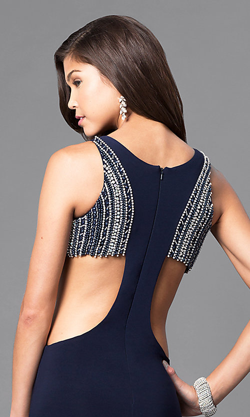 Image of navy blue long formal dress with side cut outs. Style: DJ-A4739 Detail Image 2