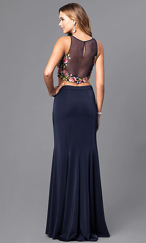 Image of long two-piece navy prom dress with embroidered top. Style: DJ-3064 Back Image