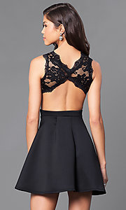 Image of mock two-piece short black a-line dress. Style: DC-44500 Back Image