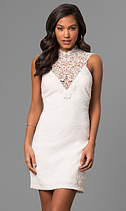 Image of textured short white party dress with lace neckline. Style: DMO-J316337 Front Image