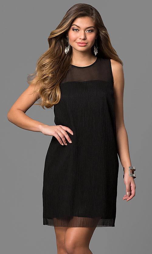 Image of short black cocktail party dress with sheer overlay. Style: BC-SVM62J55 Front Image