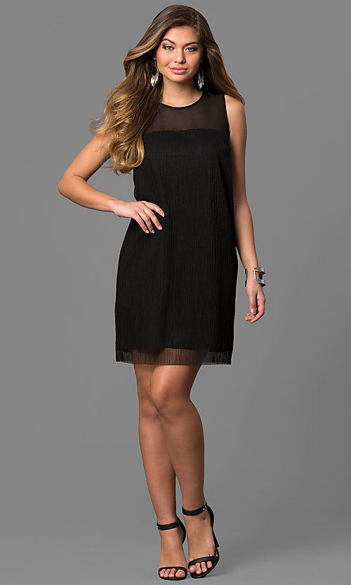 Image of short black cocktail party dress with sheer overlay. Style: BC-SVM62J55 Detail Image 1
