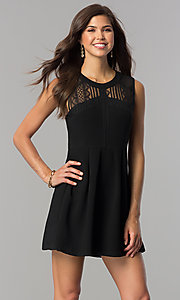 Image of short black wedding-guest party dress with lace yoke. Style: BC-GEF61M07 Front Image