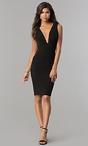 Image of short black cocktail party dress with low v-neck. Style: AC-DE22784R Detail Image 1