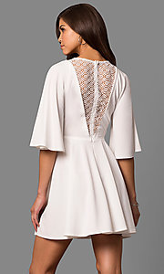 Image of short a-line party dress with bell sleeves. Style: LP-24581 Back Image