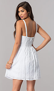 Image of short white semi-casual cruise party dress with bow. Style: EM-FBH-2945-100 Back Image