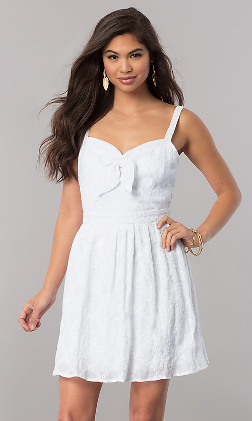 Image of short white semi-casual cruise party dress with bow. Style: EM-FBH-2945-100 Front Image