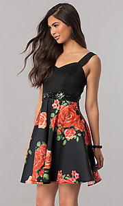 Image of floral-print short black homecoming party dress. Style: MCR-2431 Front Image