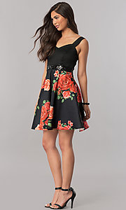 Image of floral-print short black homecoming party dress. Style: MCR-2431 Detail Image 1