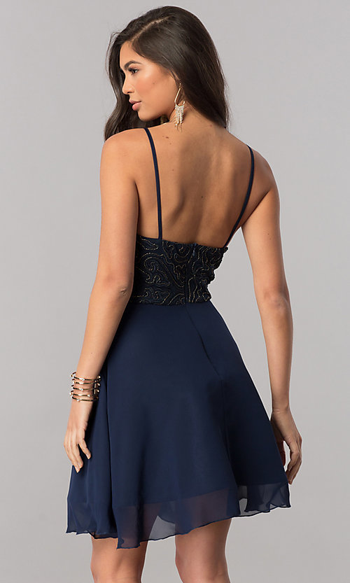Image of short homecoming party dress with embroidered bodice. Style: MCR-2427 Back Image