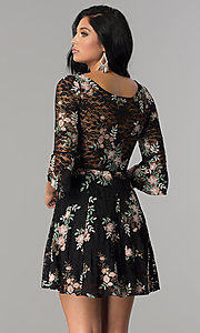 Image of short embroidered black lace party dress with sleeves.  Style: EM-FNI-3322-013 Back Image