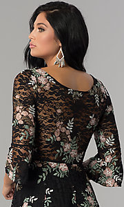 Image of short embroidered black lace party dress with sleeves.  Style: EM-FNI-3322-013 Detail Image 2