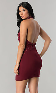 Image of short homecoming dress with beaded high-neck halter.  Style: NA-6309 Back Image