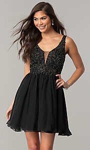 Image of black short homecoming party dress with beading. Style: NA-6291 Front Image