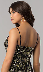 Image of short black holiday party dress with gold print. Style: EM-FFN-3201-030 Detail Image 2