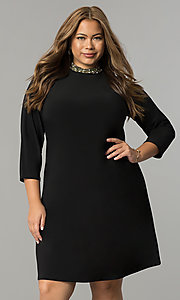 Image of black plus-size short party dress with sleeves. Style: JU-TI-T90544 Front Image