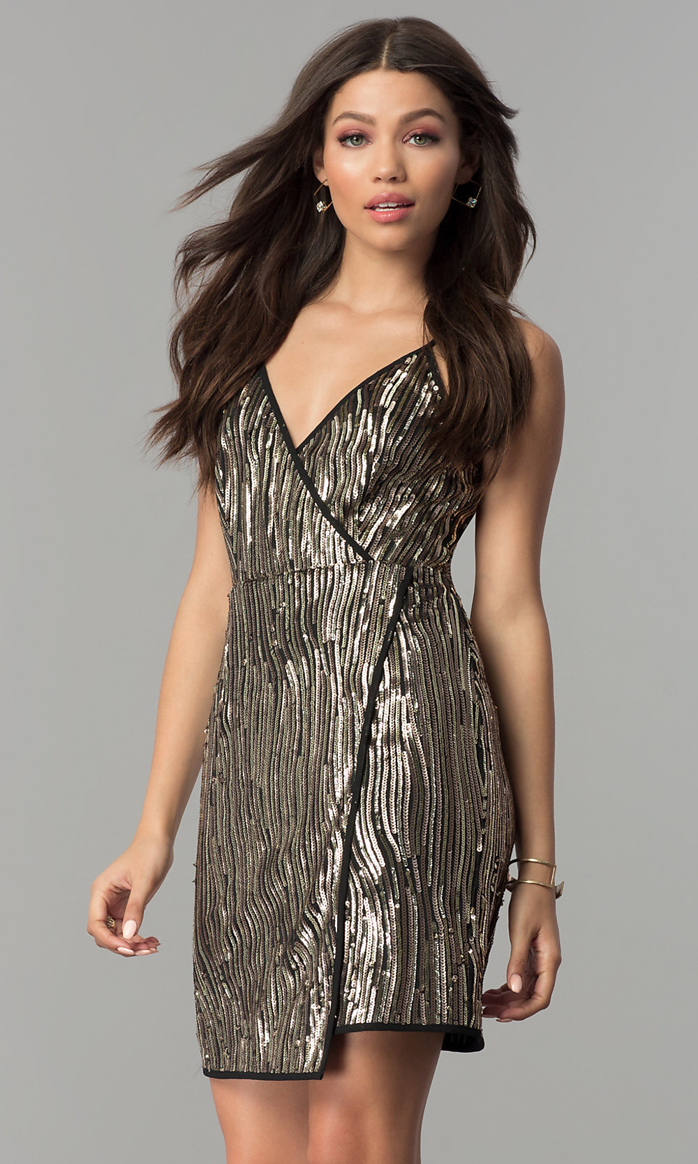 2d960350e5c8f5 Tap to expand · Image of short gold sequin mock-wrap party dress.