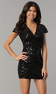 Image of short black sequin holiday party dress with sleeves. Style: JTM-JMD8279 Front Image