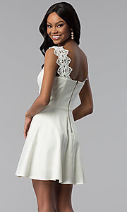 Image of ivory white short graduation dress with pockets. Style: ESL-62009D-K Back Image