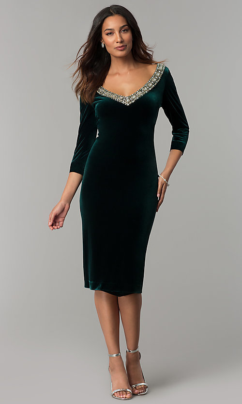 Image of knee-length hunter green velvet holiday party dress. Style: IT-110497 Front Image