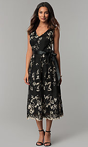 Image of embroidered tea-length black party dress with sash. Style: IT-111687 Front Image