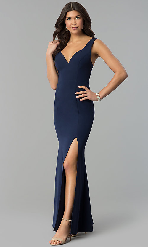 Image of navy blue v-neck long caged-back prom dress. Style: MT-8985 Front Image