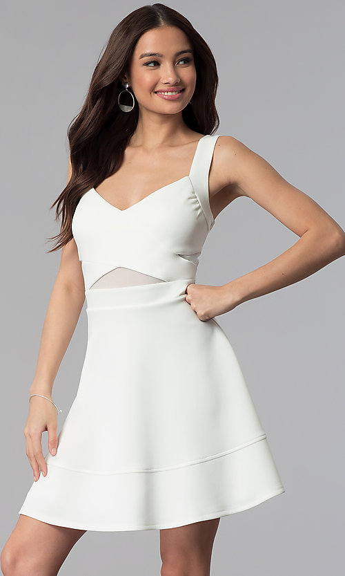 Image of ivory white a-line short party dress with cut outs. Style: EM-FLC-1003-120 Front Image