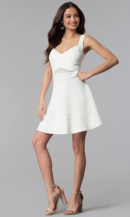 Image of ivory white a-line short party dress with cut outs. Style: EM-FLC-1003-120 Detail Image 3