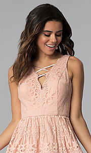 Image of short lace graduation party dress in blush pink. Style: DMO-J320477 Detail Image 1