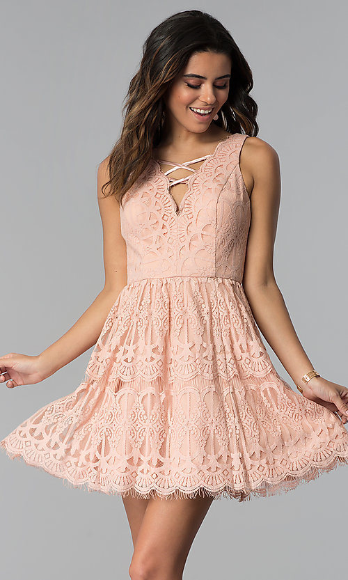 Image of short lace graduation party dress in blush pink. Style: DMO-J320477 Front Image