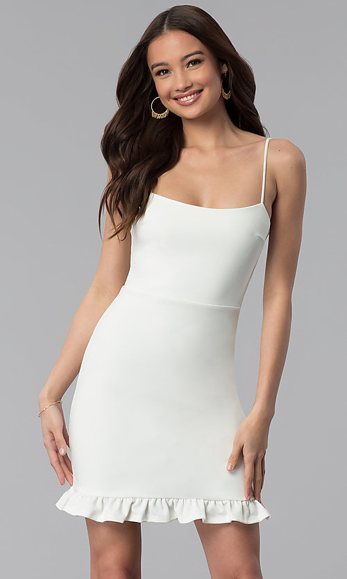 Image of short white party dress with spaghetti straps. Style: JTM-JD8354 Front Image
