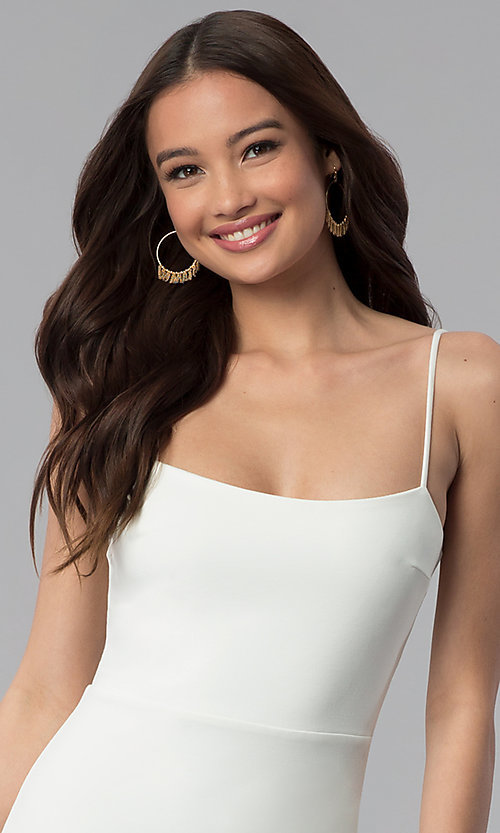 Image of short white party dress with spaghetti straps. Style: JTM-JD8354 Detail Image 1