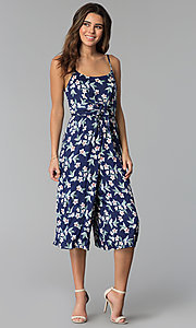 Image of cropped-leg navy blue jumpsuit with floral print. Style: AS-A8967D66A67 Front Image