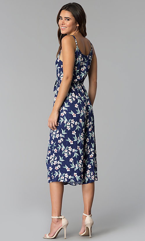 Image of cropped-leg navy blue jumpsuit with floral print. Style: AS-A8967D66A67 Back Image
