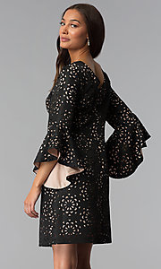 Image of laser-cut short black party dress with sleeves. Style: JX-1XBJ215J Back Image
