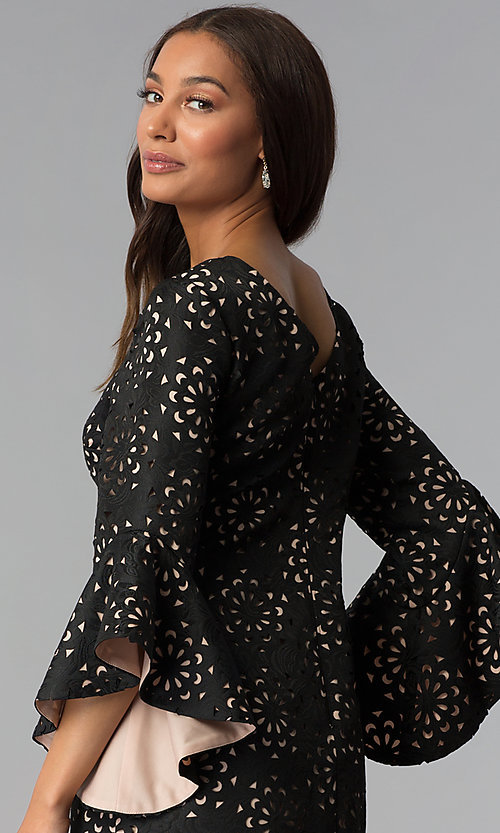 Image of laser-cut short black party dress with sleeves. Style: JX-1XBJ215J Detail Image 2