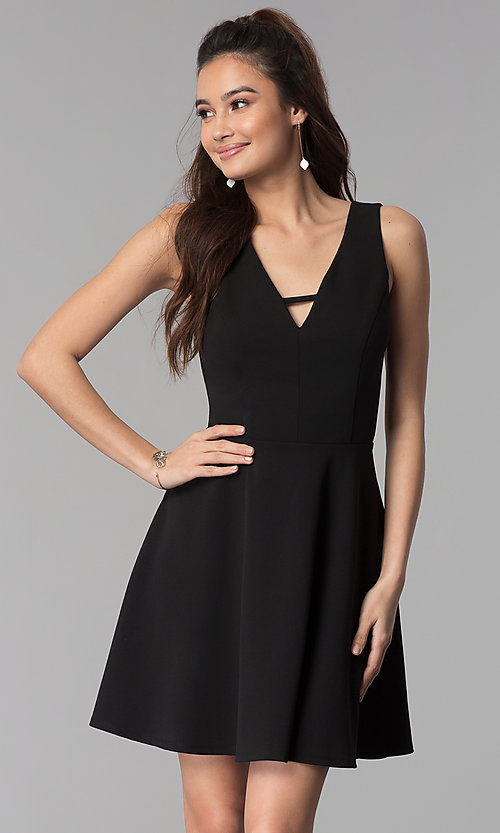 Image of v-neck short black cruise party dress. Style: CT-7711QQ2AT3 Front Image