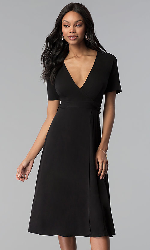 Image of faux-wrap sleeved short black wedding-guest dress. Style: RO-R66609 Front Image