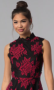 Image of black party dress with red floral-print lace applique. Style: CT-3551PV9LT1 Detail Image 1