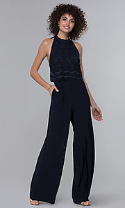 Image of wedding guest lace-popover halter navy blue jumpsuit. Style: JU-MA-261315a Front Image