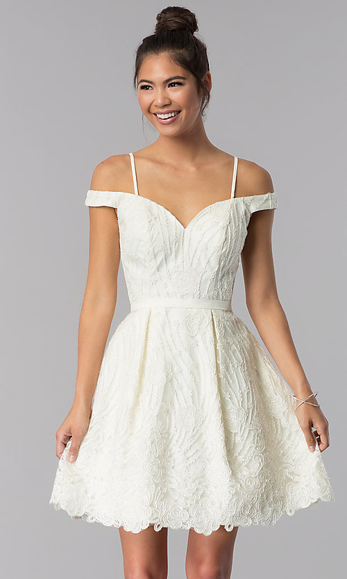 Image of ivory embroidered short sweetheart homecoming dress. Style: TE-T3090 Front Image