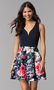 Image of sleeveless hoco party dress with floral-print skirt. Style: MCR-1995 Front Image