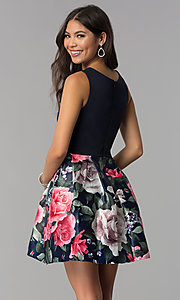 Image of sleeveless hoco party dress with floral-print skirt. Style: MCR-1995 Back Image
