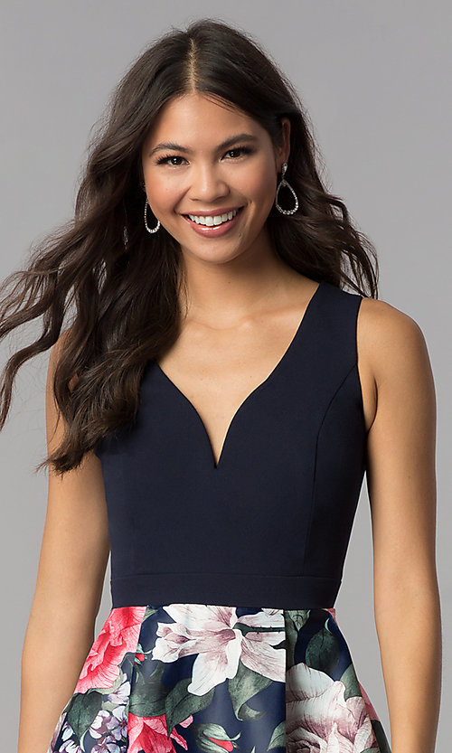 Image of sleeveless hoco party dress with floral-print skirt. Style: MCR-1995 Detail Image 1
