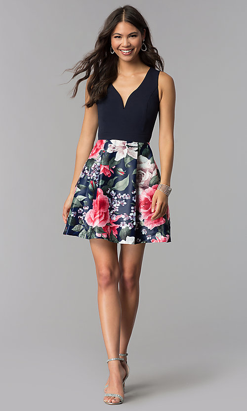 Image of sleeveless hoco party dress with floral-print skirt. Style: MCR-1995 Detail Image 2