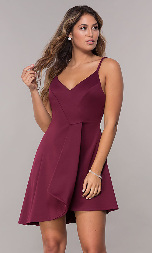Image of wine red short party dress with asymmetrical hem. Style: EM-HAA-1003-562 Front Image