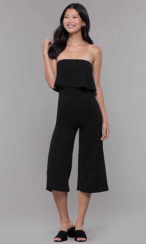 Image of knee-length popover strapless black party jumpsuit. Style: BLU-BR1288 Front Image