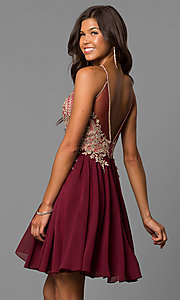 Image of short black homecoming dress with beaded bodice. Style: DJ-A6226b Back Image